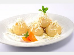Apricot Dumplings with Cottage cheese, Melted Butter and Sugar