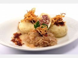 Stuffed Potato Dumplings with Smoked Meat, Sauerkraut and Fried Onions