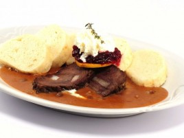 Marinated Beef in Cream Sauce with Cranberries and with Bread Dumplings